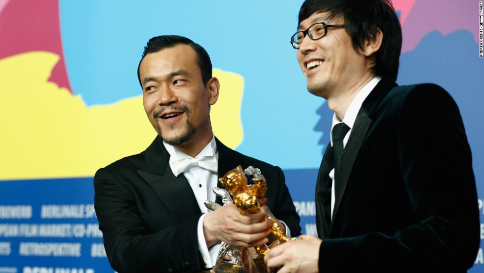 """We don't want to be liked just for being overtly political. We have our own understanding of film. We want to conquer you with beauty and with Eastern sensibilities,"" says director Diao Yinan (right). He received the Golden Bear at the 2014 Berlinale."