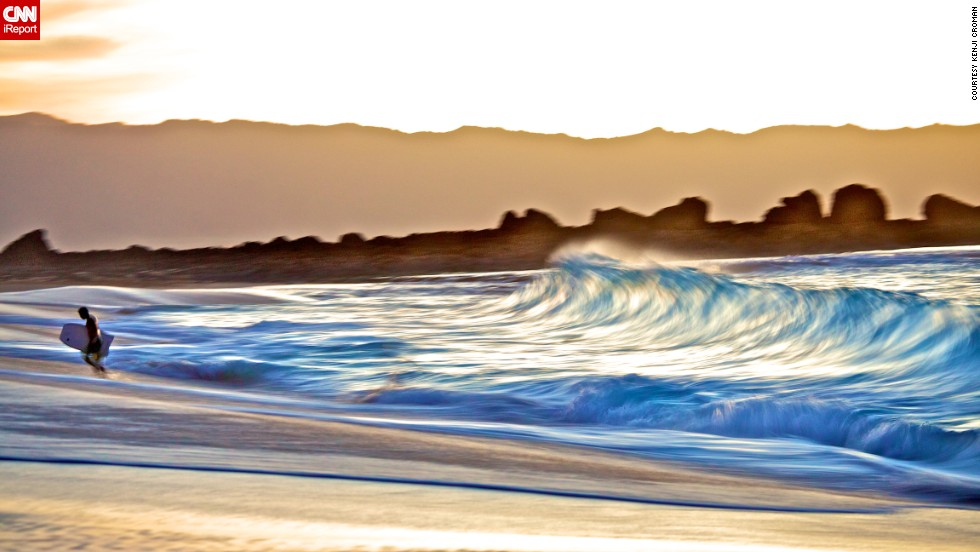 """Using a slow shutter speed, Croman was able to make the waves on Ke Iki Beach in Oahu, Hawaii, look like they were breaking on the shore in slow motion. """"The waves get so nice here, and I proposed to my wife here,"""" he says."""
