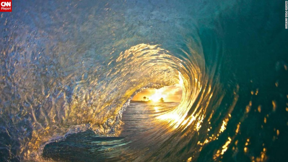 """It took Croman six months to get what he calls """"the Shot,"""" taken at Sandy Beach. He woke up at 4:30 every morning to try and photograph the sun inside the barrel of a wave."""