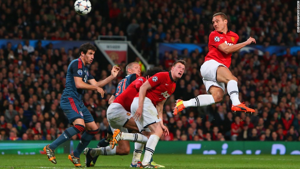Nemanja Vidic of Manchester United heads in the first goal during the UEFA Champions League quarterfinal first leg between Manchester United and Bayern Munchen at Old Trafford.