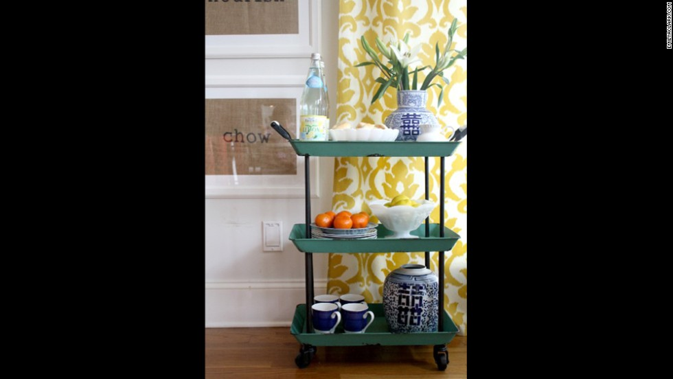 A small cart in the kitchen adds a pretty injection of Clark's favorite blue.
