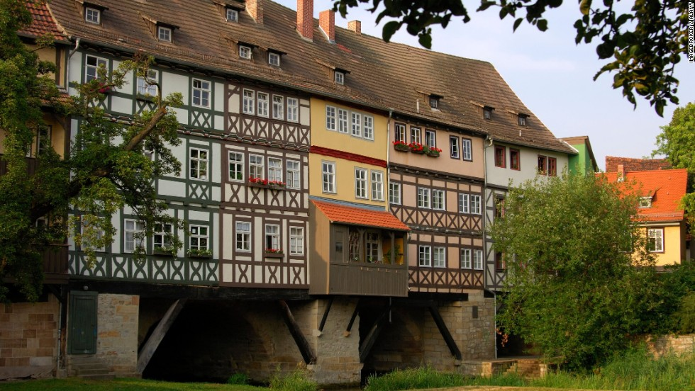 Krämerbrücke, the longest inhabited bridge, is located in Erfurt, Germany. It's a stone arch bridge dating back to 1325. Some 32 of the 62 houses added on top survive.