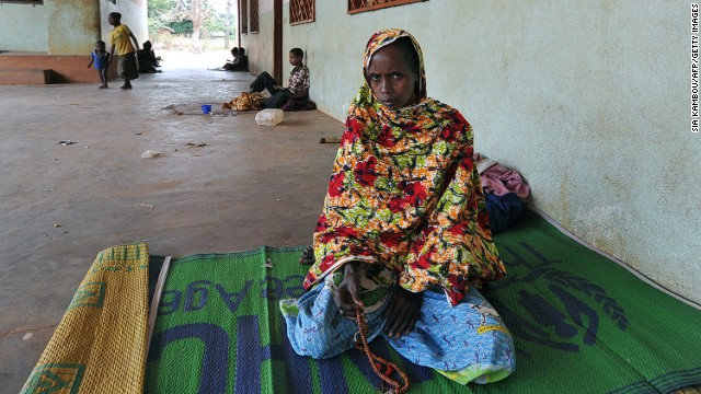 A muslim woman sits in the courtyard of the Catholic church of Bossamptele where she has taken refuge on March 7, 2014.