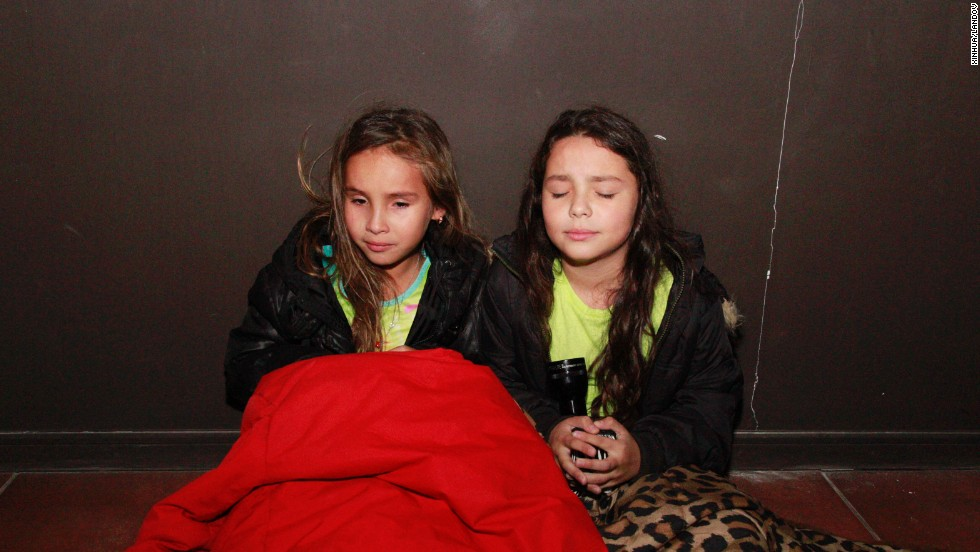 Girls wait in a hallway before evacuating Iquique on April 1.