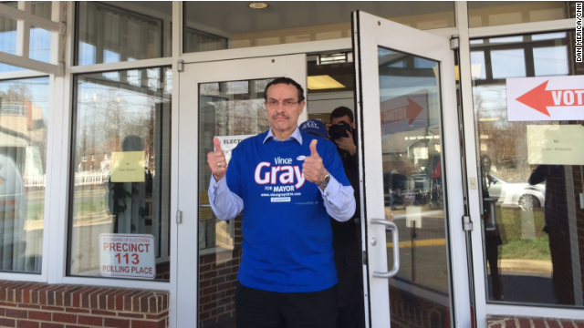 Incumbent D.C. Mayor Vincent Gray throws a couple thumbs up as he emerges from a polling place after voting Tuesday. Gray lost to challenger Muriel Bowser in the Democratic primary.