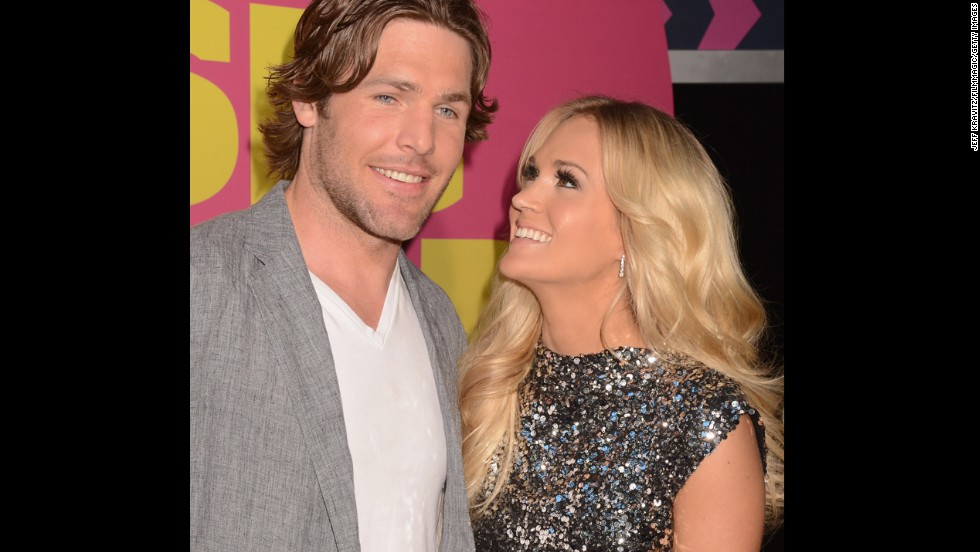 "<strong>Mike Fisher </strong>and<strong> Carrie Underwood:</strong> As one of music's top-selling artists, Carrie Underwood is far more than a hockey player's wife -- but that doesn't mean she doesn't <a href=""http://marquee.blogs.cnn.com/2011/01/07/carrie-underwood-loves-being-a-hockey-wife/?iref=allsearch"" target=""_blank"">enjoy every moment of it</a>. The ""American Idol"" champ married Canadian hockey star Mike Fisher in 2010 after a little more than a year of dating. ""You make my life better in every way!"" Underwood gushed of her athlete love in the liner notes for her 2009 album, ""Play On."" ""I thank God for you every day."""