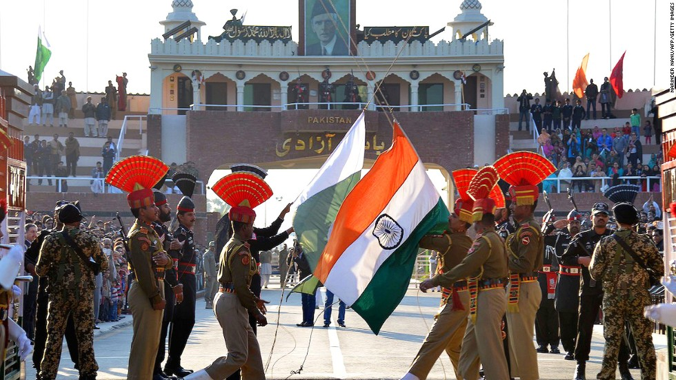 Pakistani Rangers (in black) and Indian Border Security Force personnel (in brown) perform the daily retreat ceremony on the India-Pakistan Border at Wagah.