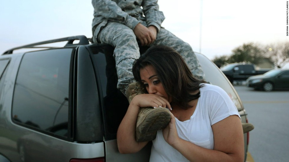 Luci Hamlin and her husband, Spc. Timothy Hamlin, wait to get back to their home at Fort Hood after a shooting at the Texas Army post on Wednesday, April 2. Multiple people were killed and others injured when a shooter opened fire, a senior military official and law enforcement official told CNN. The officials said the suspected shooter was among the dead.