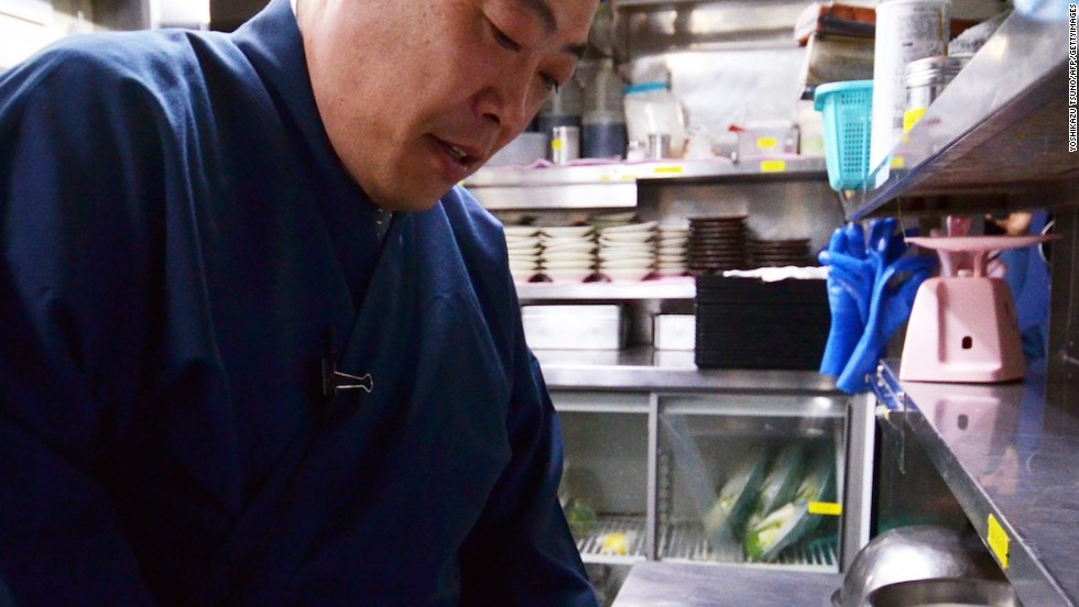 Chef Shigekazu Suzuki slices a puffer fish, known as fugu in Japan, to remove toxic internal organs at his Tokyo restaurant Torafugu-tei. Often served in sashimi form, fugu is famed for its subtle but flavorful taste.