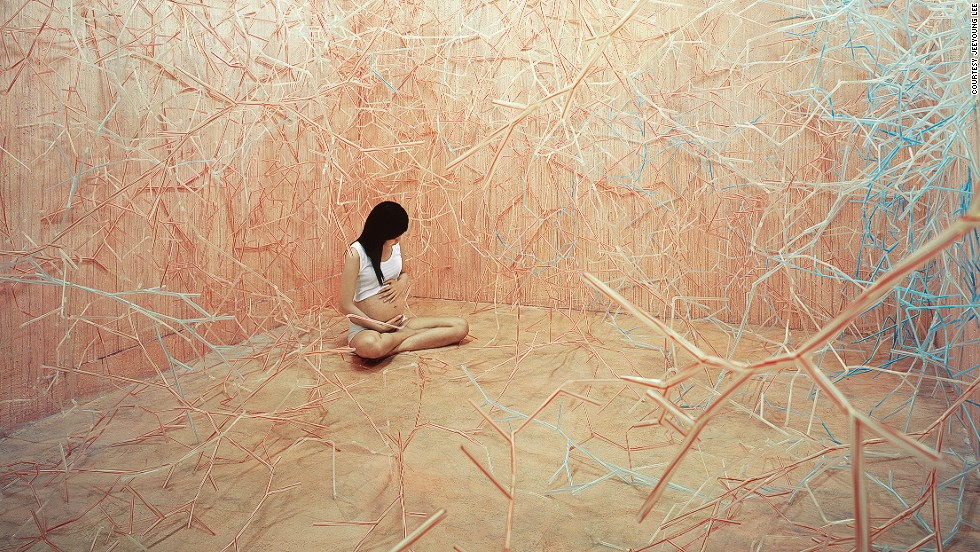 """<em>Foodchain</em><br /><br />Sharp spindly veins seem to be charging toward the pregnant woman in the photo, and the imagery of blood vessels alludes to the inside of a womb. Lee explains: """"This work is an expression of my premature self who isn't ready to go out into the world, and it is also a hint at new hope for the imminent baby or possibilities."""""""