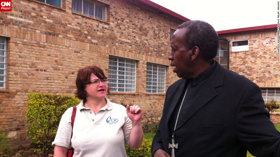 Leann Hager, Catholic Relief Services country representative in Rwanda until 2014, speaks with a local bishop about working together to reconcile communities after the genocide.