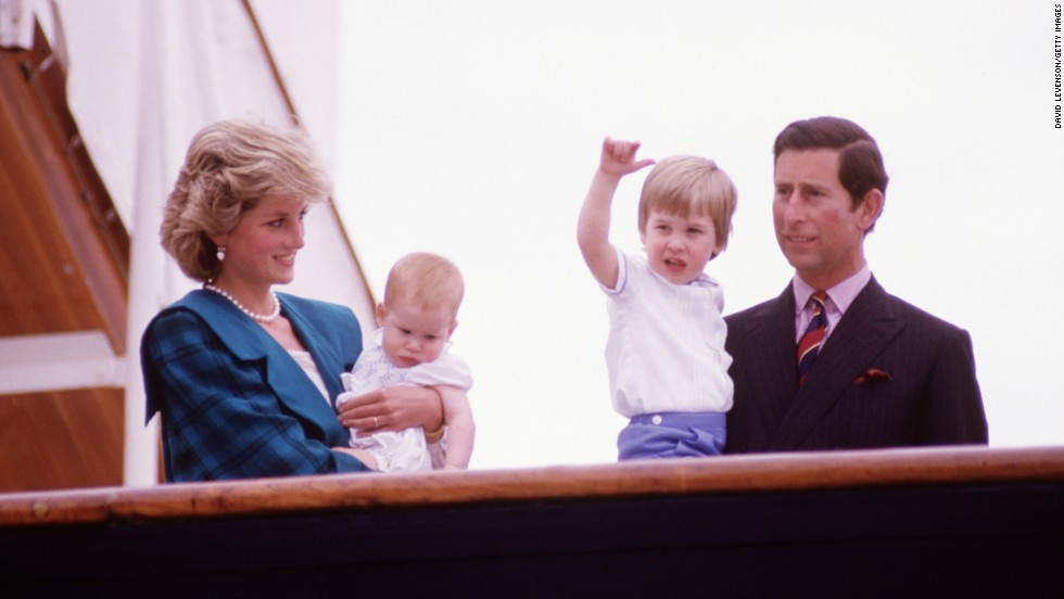 Princess Diana and Prince Charles hold Harry, left, and William on the deck of the Royal Yacht Britannia during a tour of Italy in May 1985.