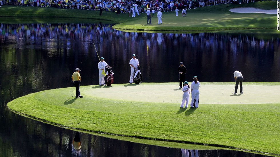 "Palmer putts as fellow greats Jack Nicklaus (left) and Gary Player (center) look on during the Par 3 Contest prior to the 2011 Masters at the course the American called ""a pleasure to play on."""