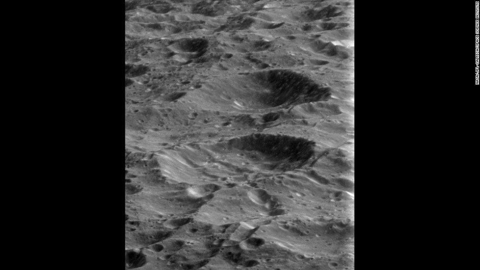 Rhea's surface is pockmarked with craters from billions of years of impacts. The moon is Saturn's second-largest, with a diameter of 949 miles.