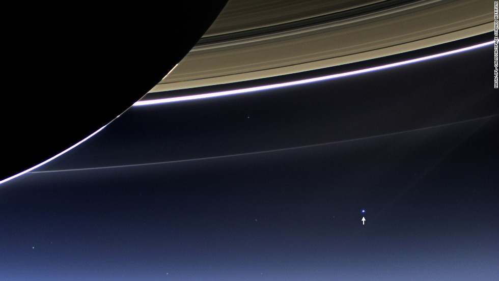 "The small bright dot seen in the bottom right is not another Saturn moon. It's Earth. The distance between Saturn and our planet is constantly changing because both are constantly in motion. When they are closest together during their orbits, Saturn is 746 million miles away from Earth. At its farthest, they are just over a billion miles apart. <a href=""http://www.cnn.com/2014/06/27/tech/gallery/cassinis-top-discoveries/index.html"" target=""_blank"">See Cassini's top 10 discoveries about Saturn</a>"