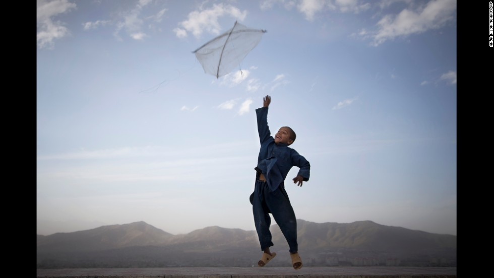 An Afghan boy flies his kite in May on a hill overlooking Kabul.