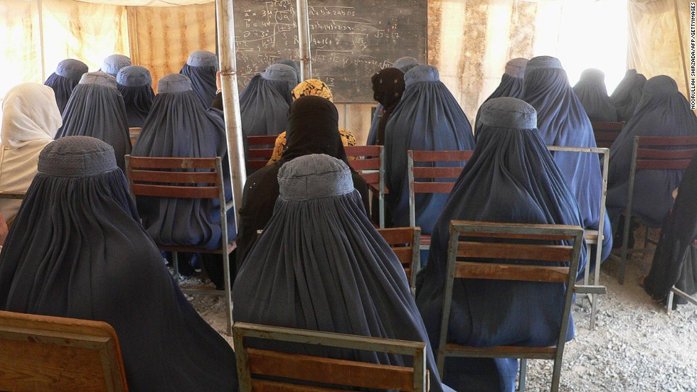 "Afghan female university students, dressed in the traditional blue burqa, attend a math class under a tent at the Nangarhar University campus in Jalalabad in September  2012. Under Taliban rule, between 1994 and 2001 <a href=""http://www.cnn.com/2012/03/08/opinion/afghanistan-women-rights-barr/"">women were banned from education and work</a>, even from leaving their homes unaccompanied."