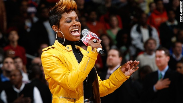 Grammy Award-winning singer and songwriter Kandi Burruss performs the National Anthem before the game between the Atlanta Hawks and the Orlando Magic at Philips Arena on November 26, 2009 in Atlanta, Georgia.