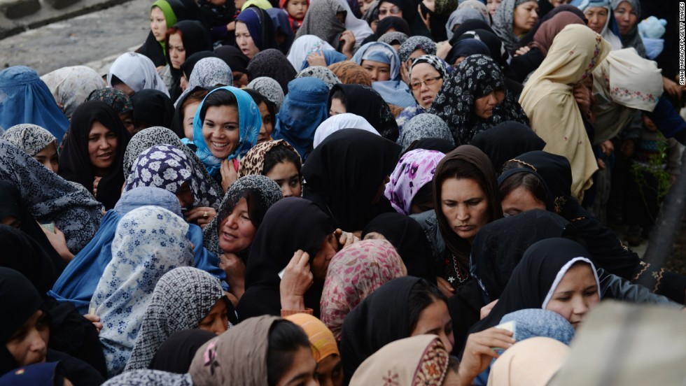 Female voters crowd outside a polling station in Kabul.