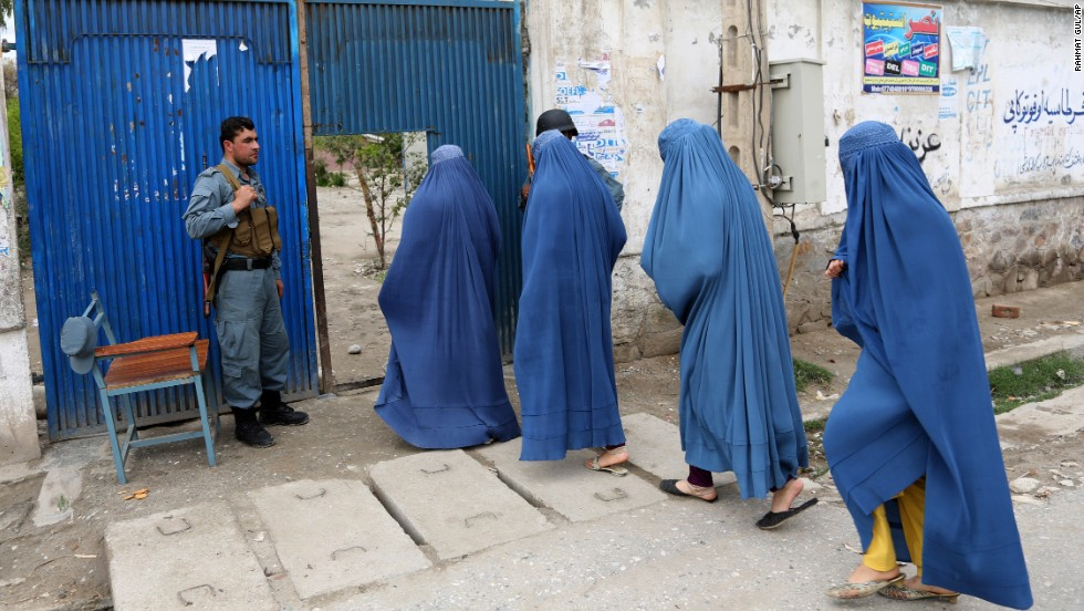 Women enter a polling station to vote in Jalalabad.