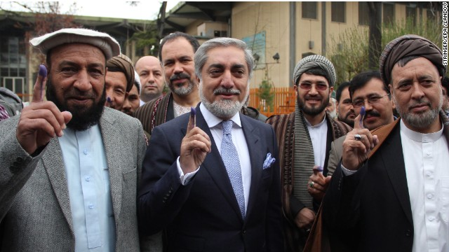 Presidential candidates Dr. Abdullah Abdullah, center, and his running mates cast their ballots in Kabul.