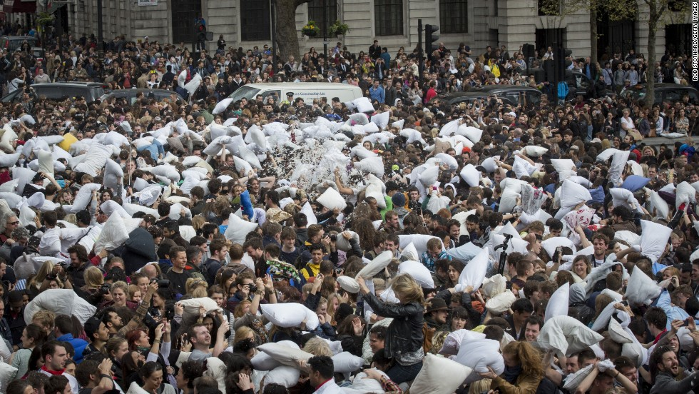 A crowd of pillow warriors fills the north terrace of Trafalgar Square.