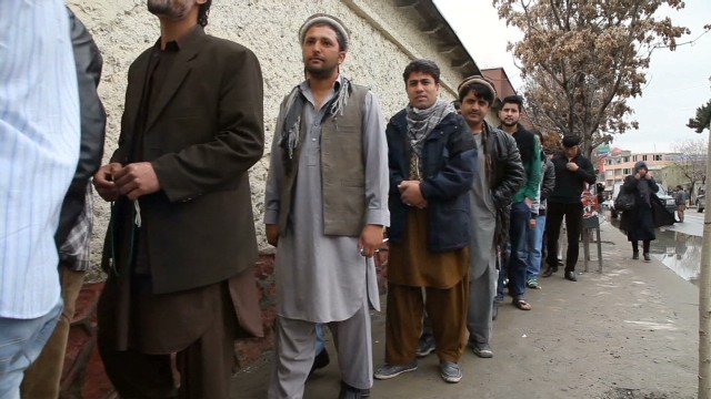 Afghans vote for future despite threats