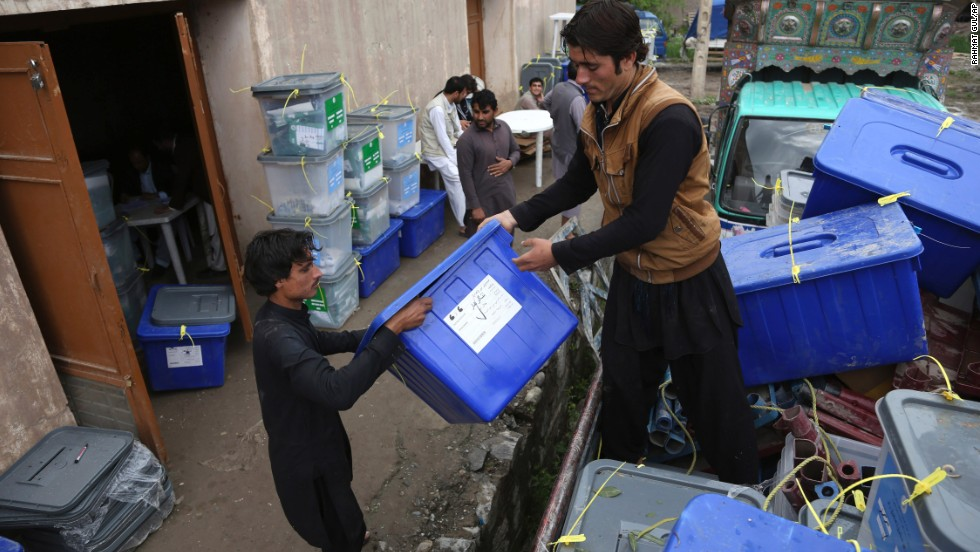 Workers at the Afghan Election Commission office unload ballot boxes from a truck on Sunday, April 6. Ballot boxes from Afghanistan's 34 provinces were being transferred to the capital, Kabul, after preliminary counts at the polling sites, an official said. Afghan voters turned out in large numbers Saturday for historic presidential and provincial elections.