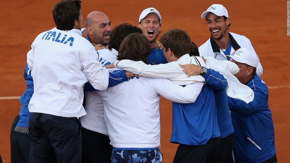 The Swiss will next face a jubilant Italian team, here celebrating after also coming from a 2-1 deficit to beat Britain. Fabio Fognini upset world No. 8 Andy Murray before  Andreas Seppi dispatched James Ward in the decider in Naples.