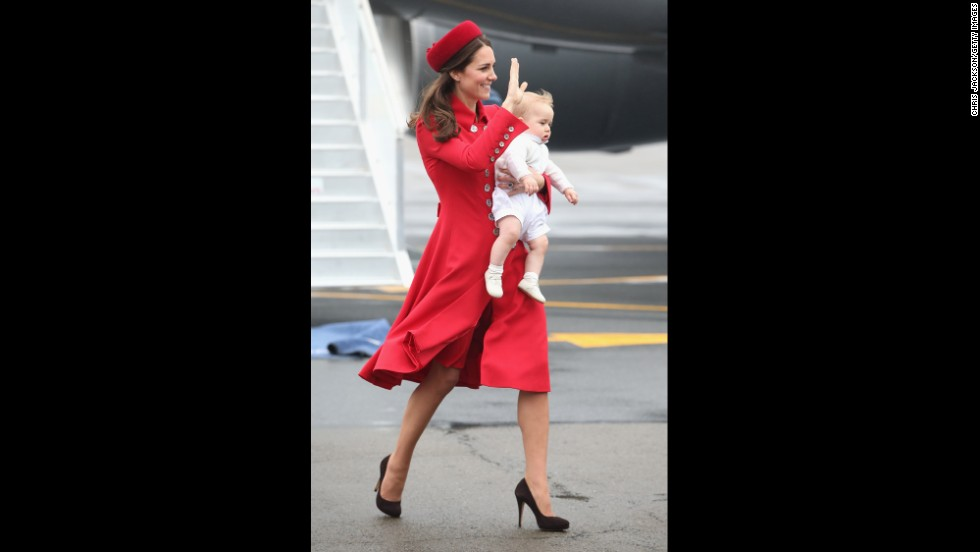 Catherine carries Prince George as they arrive for the start of the tour.