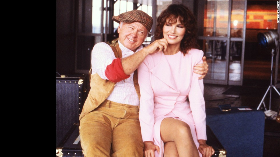 "Rooney is seen with Raquel Welch in 1980 from the ABC series ""Raquel."""