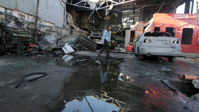 Palestinians inspect the rubble of a destroyed metal workshop after it was hit by an Israeli missile strike in Jabaliya refugee camp, in the northern Gaza Strip, Friday. The following night, Israeli warplanes struck five targets in Gaza.