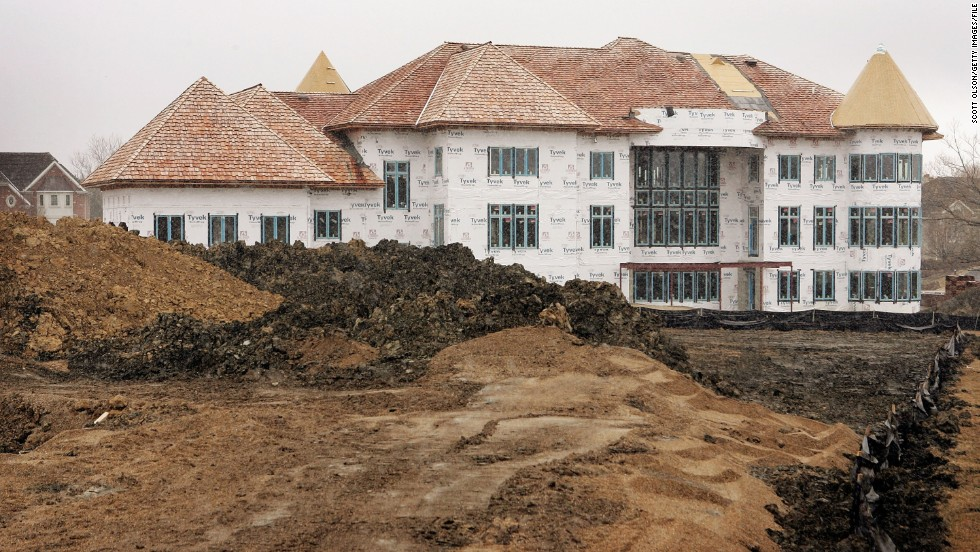 Home construction in Inverness, Illinois, in 2006. Risky mortgage lending was packaged by banks that sought to make big profits. The collapse of housing bubble instigated a credit crisis that triggered the global financial meltdown of 2007.