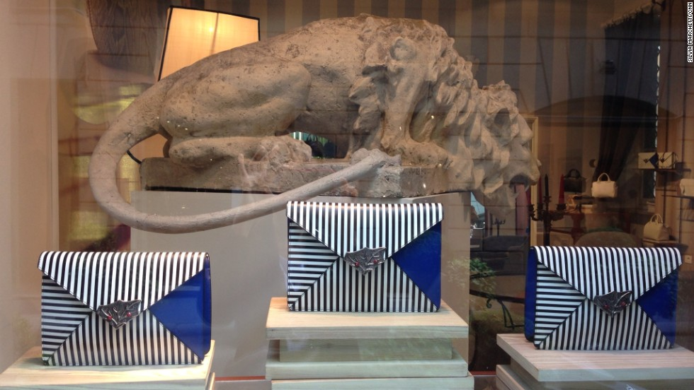 "It's not unusual to see tourists and shoppers snapping photos of store fronts. These Corto Moltedo ""Tiffany Pochette"" clutches are so glamorous, they're guarded by a stone lion."