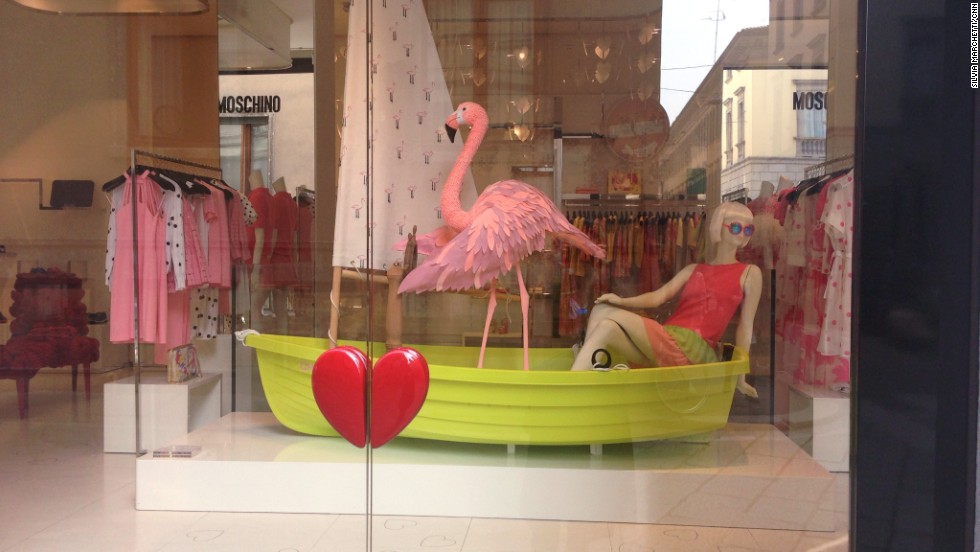 Boutiques can be works of art in themselves, set in historical buildings. Moschino's flamingo-themed decor takes window shopping to a more colorful level.