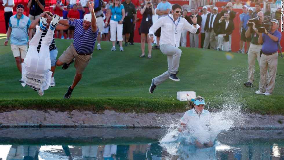 Golfer Lexi Thompson jumps into a pond Sunday, April 6, after winning the Kraft Nabisco Championship in Rancho Mirage, California.