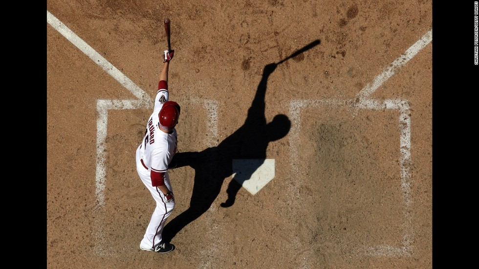 Arizona's Mark Trumbo holds up his bat during a game against San Francisco on Thursday, April 3, in Phoenix.