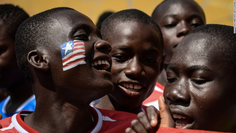 Liberian soccer players sing Tuesday, April 1, during the Street Child World Cup in Rio de Janeiro.