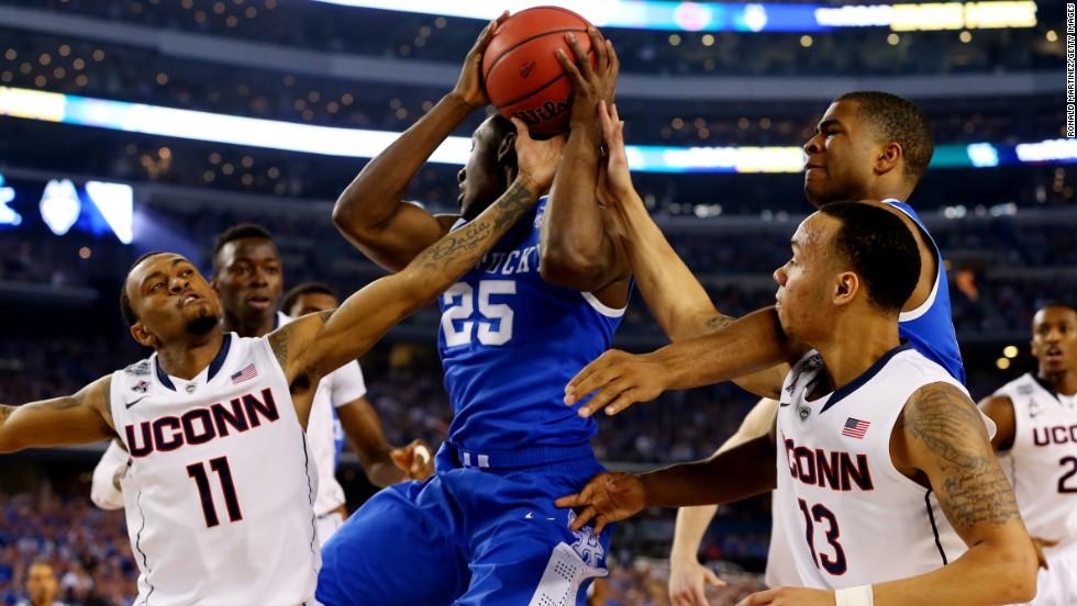 Kentucky's Dominique Hawkins, center, pulls down a rebound against Connecticut.
