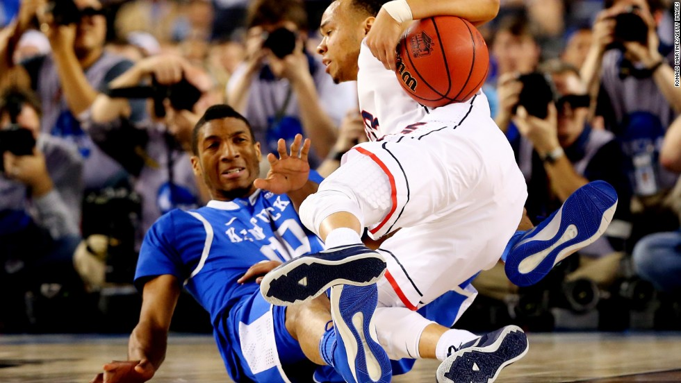 Napier falls to the ground as Kentucky forward Marcus Lee defends.
