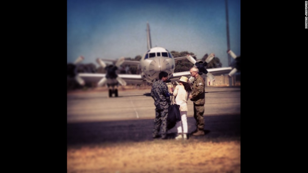 """Don't tell CNN Tokyo's Junko Ogura that she can't walk up to the flight line! She's little but she's scrappy. After sneaking away from the rest of the press, she tried to convince the commander of the Japanese search mission to take her and our camera onto the plane in the background.""  By CNN's Elizabeth Joseph at RAAF Base Pearce, April 3.  Follow Elizabeth on Instagram at <a href=""http://instagram.com/ejo1224"" target=""_blank"">instagram.com/ejo1224</a>."