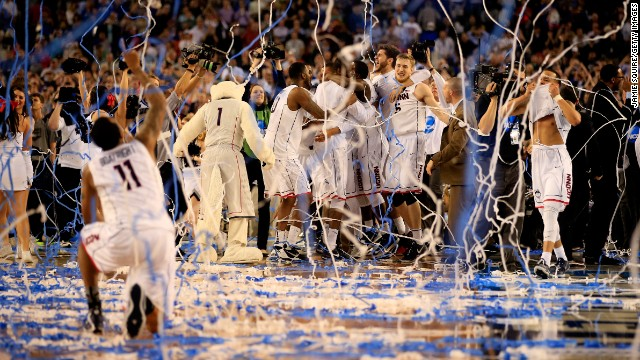 ARLINGTON, TX - APRIL 07:  The Connecticut Huskies celebrate after defeating the Kentucky Wildcats 60-54 in the NCAA Men's Final Four Championship at AT&T Stadium on April 7, 2014 in Arlington, Texas.  (Photo by Jamie Squire/Getty Images)