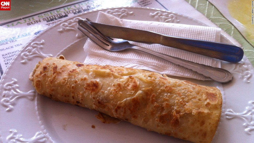 """While working in Lugazi, Uganda, in the summer of 2012 I ate some of the finest, yet simple, foods,"" said Jerry Comyn from Ireland who took this picture of a ""Rolex."" <br /><br />""From grilled chicken on a stick to fried egg wrapped in chapati (called a Rolex) to plain rice and beans, it was all delicious,"" he said."