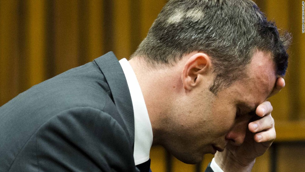 Pistorius puts his hand to his face while listening to cross-questioning on March 7.
