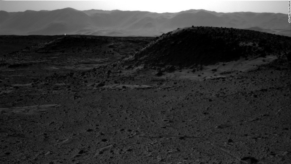 "NASA said <a href=""http://www.cnn.com/2014/04/08/us/mars-rover-image/index.html"">the bright spot in this image</a> taken in April could be merely a ""glinting rock or cosmic-ray hit."""