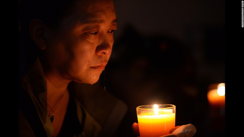 A relative of a missing passenger cries at a vigil in Beijing on April 8, 2014.