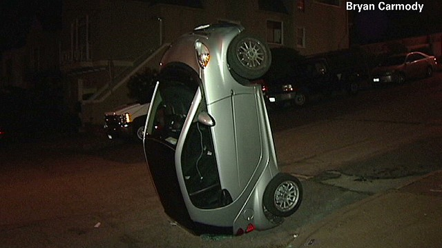 Vandals flip smart cars upside down