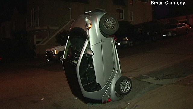 Vandals flip smart cars upside down