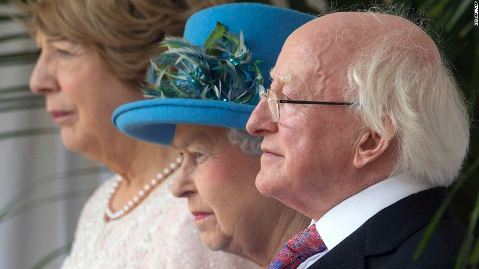 Queen Elizabeth, center, stands with Higgins and his wife during an official welcoming ceremony April 8 in Windsor, England.