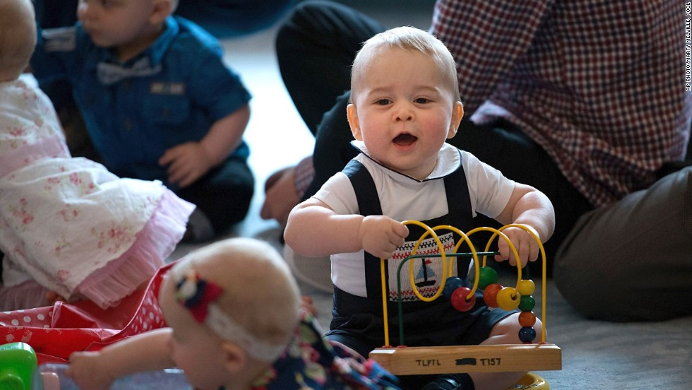 "WELLINGTON, NEW ZEALAND: Britain's Prince George plays during a visit to a parents group, his first ever public engagement. The eight-month-old future king is on a<a href=""http://edition.cnn.com/2014/04/06/world/asia/royal-family-new-zealand-visit/index.html?iid=article_sidebar""> tour of New Zealand and Australia</a> with his parents, the Duke and Duchess of Cambridge."